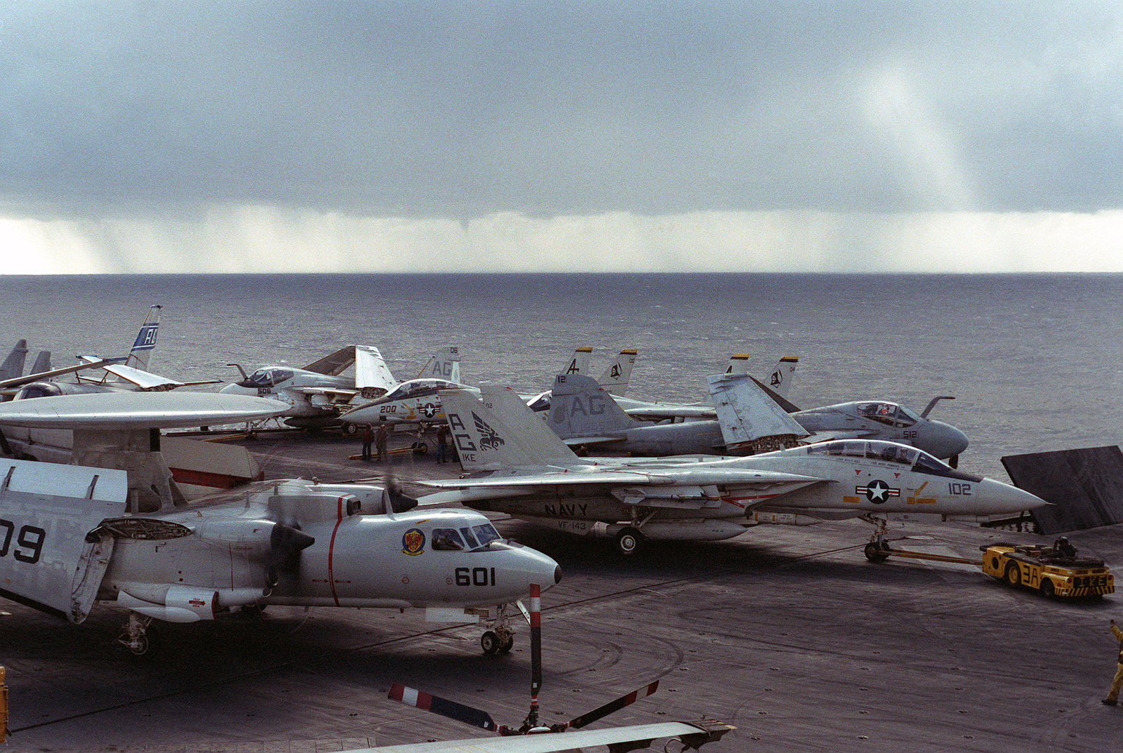 E-2C Hawkeye, left, F-14A Tomcat, center, and A-6E Intruder aircraft parked on the flight deck of the nuclear-powered aircraft carrier USS DWIGHT D. EISENHOWER (CVN 69)