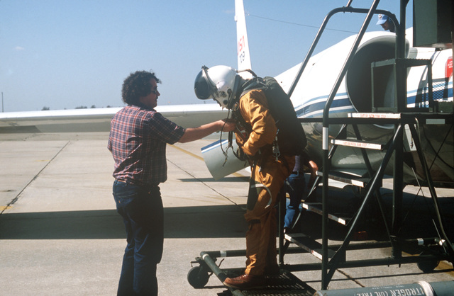 A technician has his equipment checked before boarding a NASA Earth Resources Survey aircraft, U-2, for a photographic assignment across Florida. This is a joint effort between the United States Department of Agriculture (USDA), the Animal and Plant Health Inspection Service (APHIS), and the National Aeronautics and Space Administration to help combat the state`s diseased citrus problem