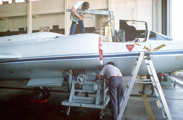 Technicians install a camera aboard a NASA Earth Resources Survey aircraft, U-2, for a photographic assignment across Florida. This is a joint effort between the United States Department of Agriculture (USDA), the Animal and Plant Health Inspection Service (APHIS), and the National Aeronautics and Space Administration to help combat the state`s diseased citrus problem