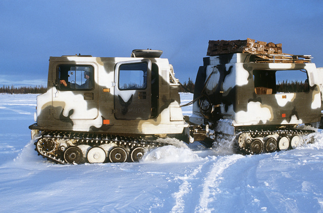 A US Army M-973 small unit support vehicle is used by the 327th Infantry Brigade to pick up airdropped supplies during Exercise BRIM FROST '85