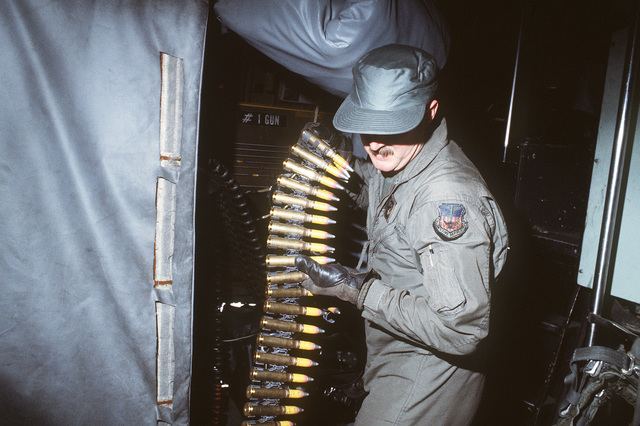 A member of the 16th Special Operations Squadron loads a 20 mm rounds onto an AC-130H Hercules aircraft during Exercise BRIM FROST '85