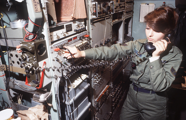 Sergeant (SGT) Anita Gordon, 3rd Combat Information Systems Group, Tinker Air Force Base, Oklahoma, checks tone levels on new communication circuits