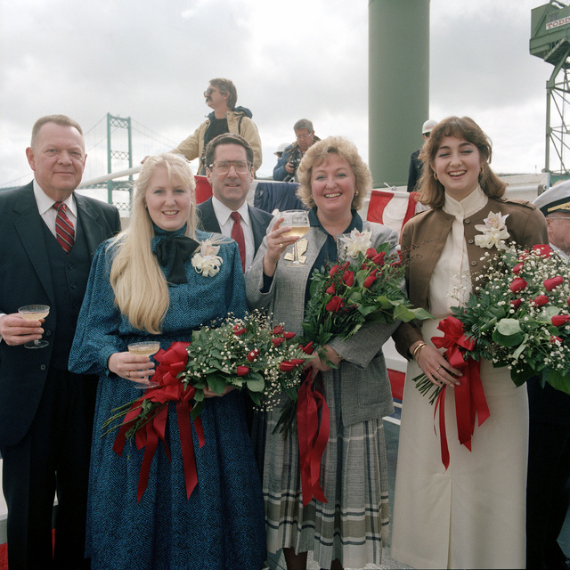 The Launching Party poses at the launching of the guided missile frigate USS REUBEN JAMES (FFG 57) at the Todd shipyard. From left to right, L.M. Thorell, general manager, Todd Pacific Shipyard; Lisa Marie Herrington, maid of honor; John S. Herrington, Under Secretary of the Navy; Lois Haight Herrington, ship`s sponsor; and Victoria Jean Herrington, maid of honor