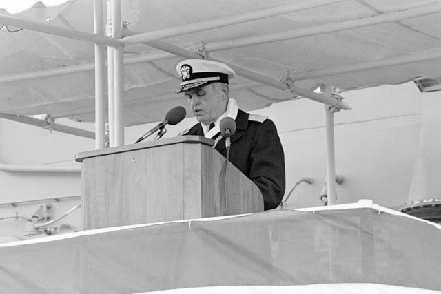 Commodore David F. Chandler, deputy commander, Naval Surface Force, US Atlantic Fleet, reads the commissioning directive during the commissioning ceremony for the Oliver Hazard Perry class guided missile frigate USS HAWES (FFG 53). The ceremony is being held at Bath Iron Works Shipyard
