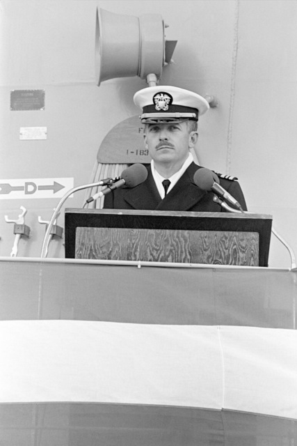 Lieutenant Commander Howard B. Sidman, executive officer, speaks during the commissioning ceremony for the Oliver Hazard Perry class guided missile frigate USS HAWES (FFG 53), being held at Bath Iron Works Shipyard
