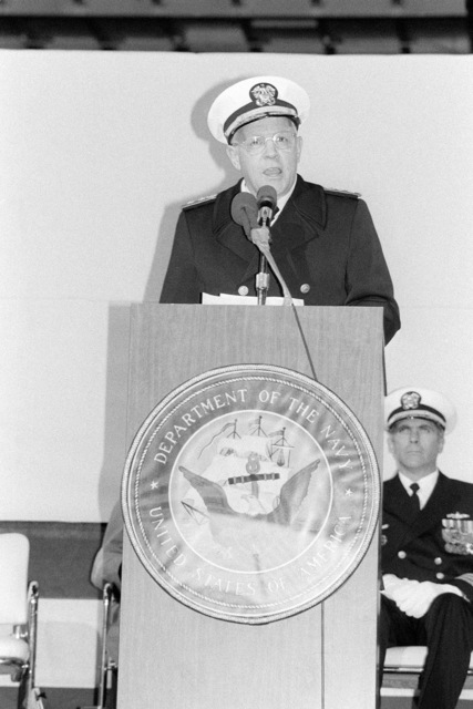 Rear Admiral (RADM) Laverne S. Severance Jr., Commander, Naval Base Seattle, addresses the guests attending the commissioning ceremony for the dock landing ship USS WHIDBEY ISLAND (LSD 41). The ceremony is being held in the well deck of the ship, docked at Lockheed Shipyard