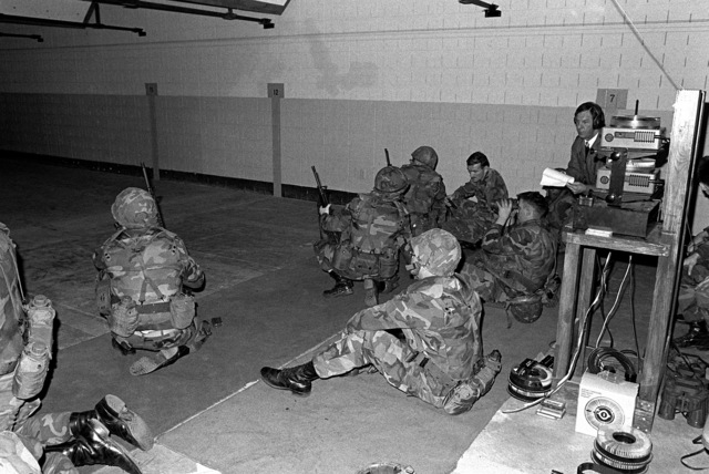 Members of the 2nd Marine Division practice with M16A2 rifles on an indoor range using the GQ Defence Equipment Ltd marksmanship training system