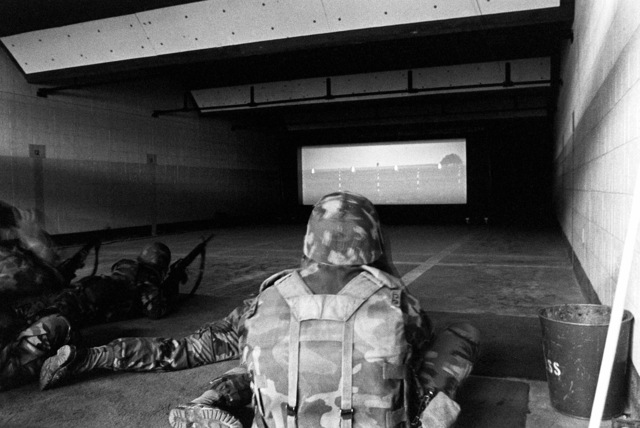 Members of the 2nd Marine Division practice with M16A2 rifles on an indoor range using the GQ Defence Equipment Ltd. marksmanship training system