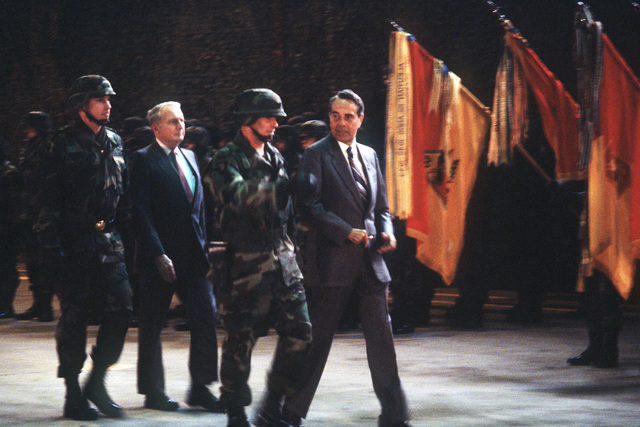 Senator Robert Dole, R-Kansas, and Secretary of the Army John O. Marsh Jr. review the troops during the activation ceremony for the 10th Mountain Division (Light Infantry)