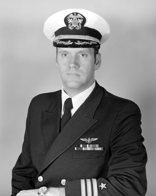 Commander Robert R. Hathaway, USN (covered)