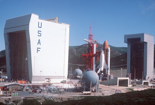 A view of the National Aeronautics and Space Administration Orbiter OV-101 Enterprise on the launch tower as it would appear prior to launch. The Enterprise is not equipped to be launched but is being used as a model at the newly constructed space shuttle launch facilities