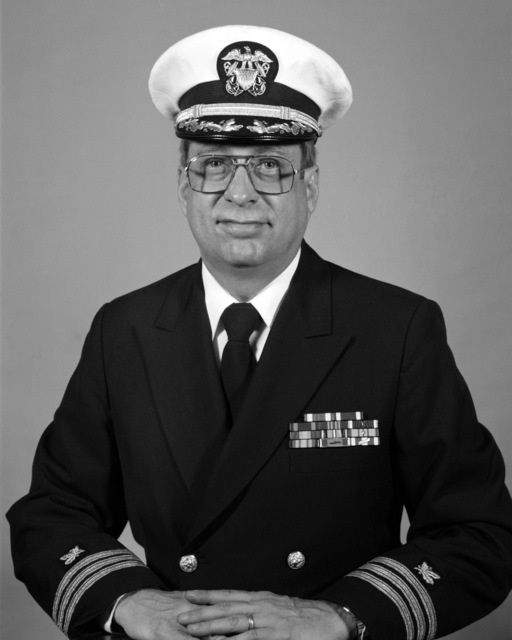 Commander Larry F. Humes, USN (covered)