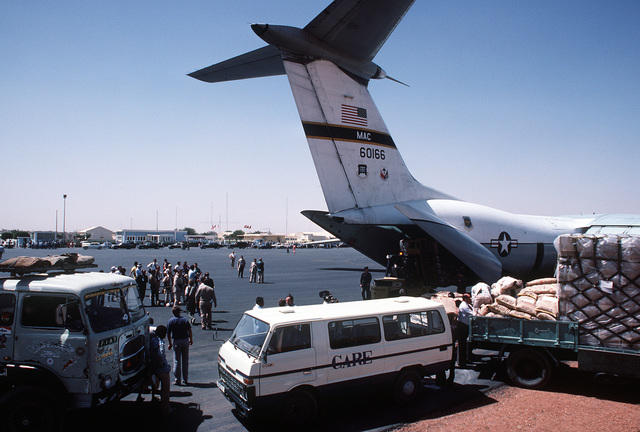 Food and supplies are unloaded from a C-141B Starlifter aircraft from the 6th Military Airlift Squadron during Ethiopian relief operations. The supplies will be moved to a distribution center and given to the needy