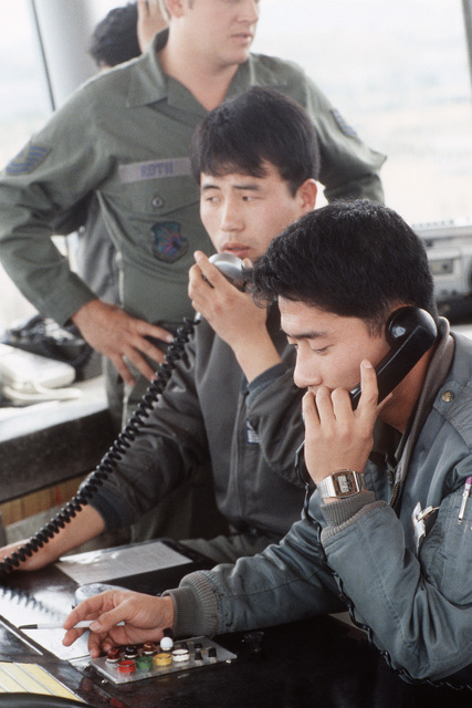 Korean air force air traffic controllers direct air traffic from the control tower during Exercise TEAM SPIRIT '85