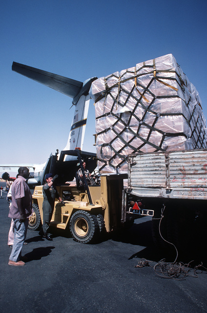 MASTER SGT. Edward Barnes, loadmaster from the 6th Military Airlift Squadron, directs the loading of one of 11 pallets of supplies onto a waiting truck during Ethiopian relief operations. The supplies will be moved to a distribution center and given to the needy