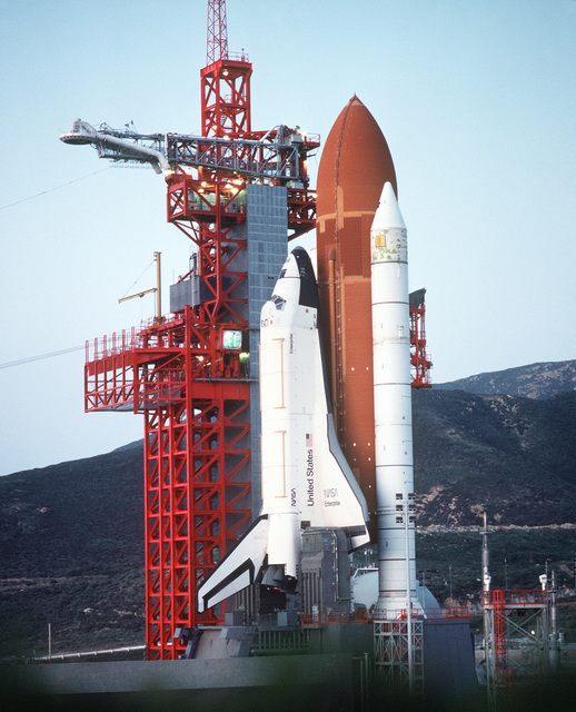 """Pre-dawn view of Space Shuttle Enterprise in launch position on the Space Launch Complex (SLC) #6, commonly known as """"SLICK 6"""", during the ready-to-launch checks to verify launch procedures. Exact Date Shot Unknown"""