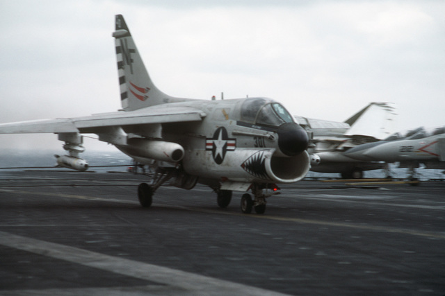 Right front view of an A-7 Corsair II aircraft coming to a stop after making an arrested landing aboard the aircraft carrier USS MIDWAY (CV 41)