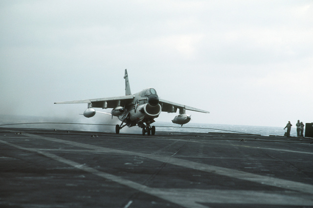 Right front view of an A-7 Corsair II aircraft making an arrested landing aboard the aircraft carrier USS MIDWAY (CV 41)