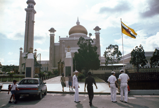 Sailors from the guided missile destroyer USS HENRY B. WILSON (DDG 7) arrive at Sultan Sir Hassanal Bolkiah's royal palace for a tour. The WILSON is the first US Navy ship to visit Brunei since the USS CONSTITUTION in 1845. PHOTO from March 1985 All Hands Magazine