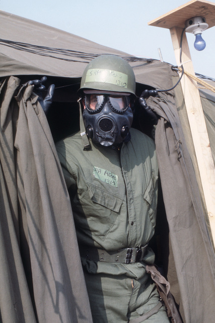 Senior AIRMAN (SRA) Thomas Akers, a 563rd Tactical Fighter Squadron life support technician, wears chemical-biological warfare gear during Exercise TEAM SPIRIT '85