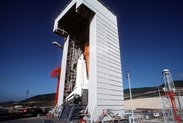 """View of Space Shuttle Enterprise in position on the Space Launch Complex (SLC) #6, commonly known as """"SLICK 6"""", with the work enclosure in place around the shuttle. Exact Date Shot Unknown"""