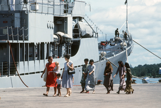 Visitors arrive for a tour of the guided missile destroyer USS HENRY B. WILSON (DDG 7). The WILSON is the first US Navy ship to visit Brunei since the USS CONSTITUTION in 1845. PHOTO from March 1985 All Hands Magazine