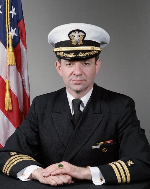 Commander (CDR) Peter Reis, USN (covered)