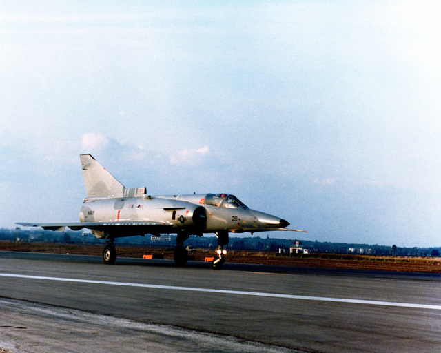 "A right front view of an F-21A Kfir (young lion) aircraft as it touches down after a test flight. The Israeli-built, delta-wing tactical fighter aircraft is being used as part of the Navy's ""aggressor"" training"