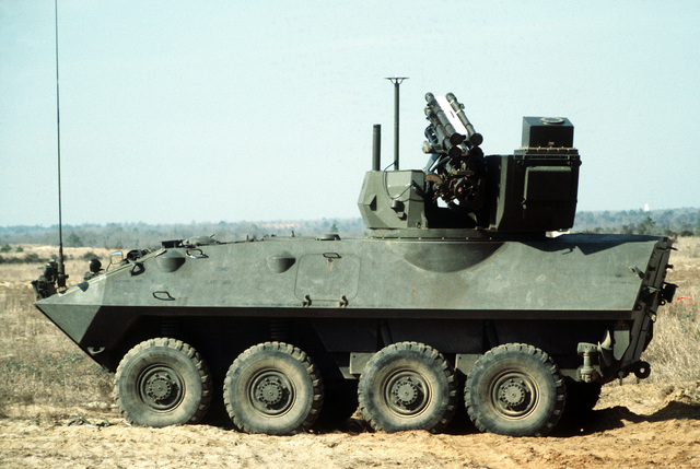 An LAV-25 light armored vehicle with an experimental turret installed during testing. The turret is equipped with a GAU-13/A 30mm lightweight gun and an FIM-92A Stinger portable anti-aircraft missile