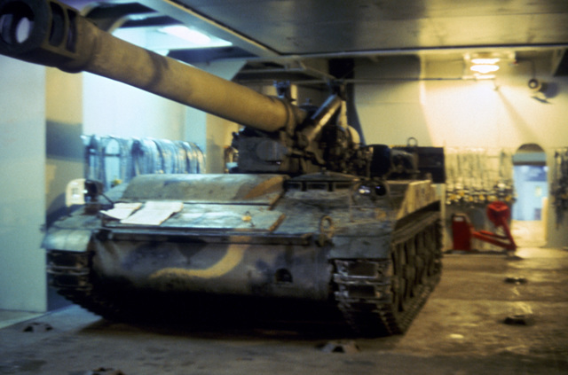 A 6th Marine Amphibious Brigade M110A2 203 mm self-propelled howitzer is ready to be tied down in a storage position aboard the Waterman class maritime prepositioning ship SS PFC. EUGENE A. OBREGON. (Substandard image)