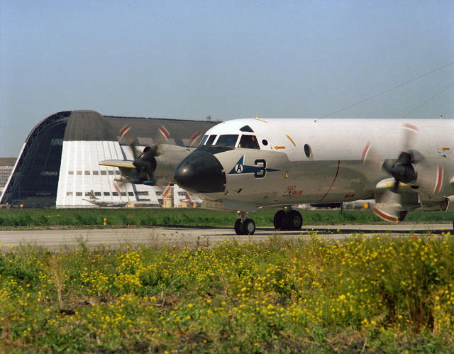 A Patrol Squadron 50 (VP-50) P-3C Orion aircraft taxi on the runway during the annual mine readiness certification inspection