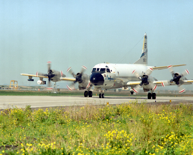 A Patrol Squadron 50 (VP-50) P-3C Orion aircraft taxis on the runway during the annual mine readiness certification inspection