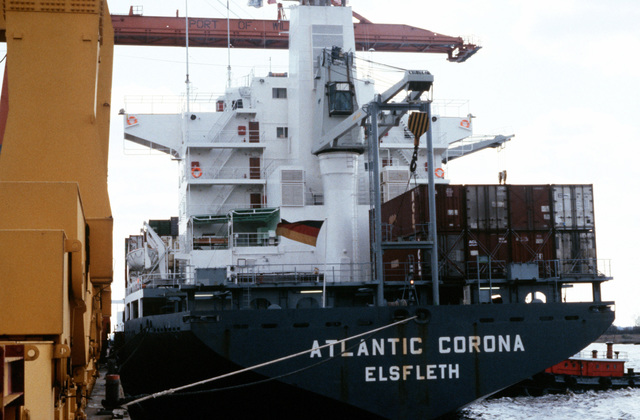 A stern view of the German container ship SS ATLANTIC CORONA moored at a pier