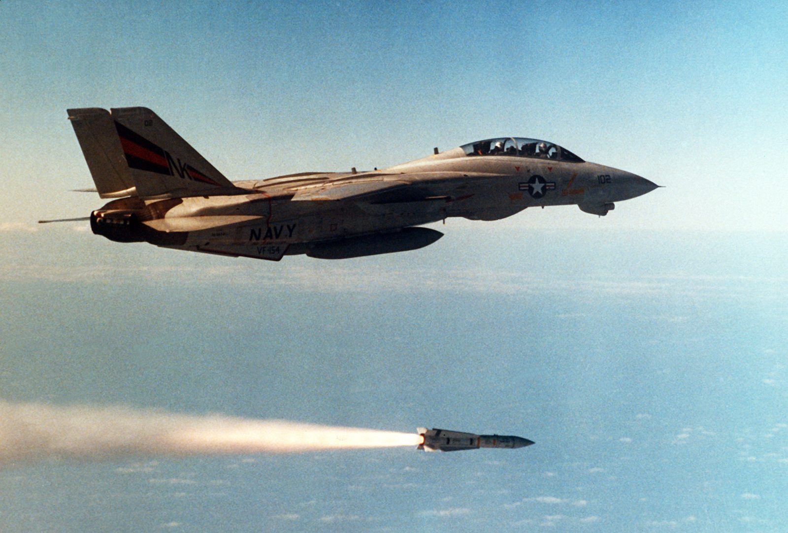 An air-to-air right view of an F-14 Tomcat aircraft from Fighter Squadron 154 (VF-154) firing an AIM-54 Phoenix missile - U.S. National Archives Public Domain Search
