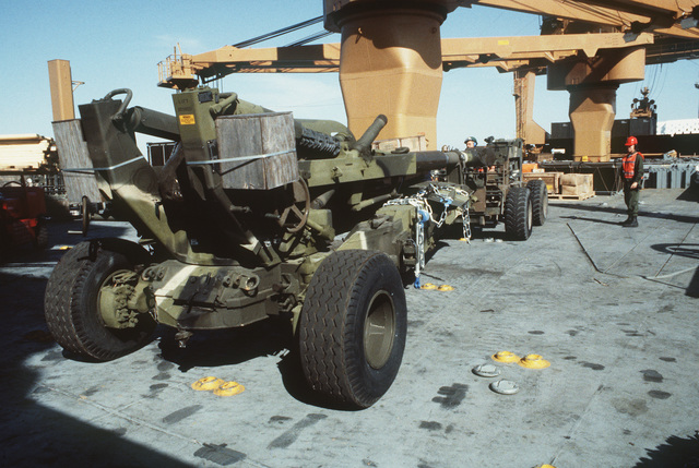 An MC4000 rough terrain forklift truck is used to maneuver a 6th Marine Amphibious Brigade M198 155 mm towed howitzer on the deck of the Waterman class maritime prepositioning ship SS PFC. EUGENE A. OBREGON