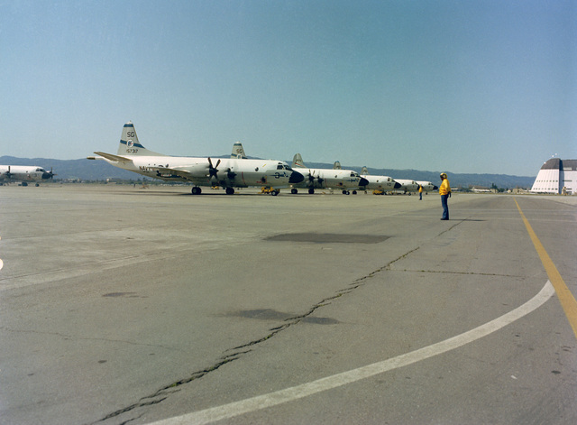 Line personnel prepare to direct the pilots of Patrol Squadron 50 (VP-50) P-3C Orion aircraft during the annual mine readiness certification inspection