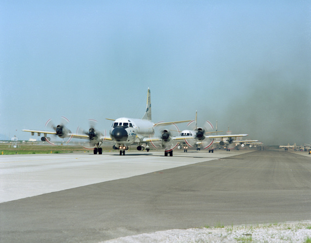 Patrol Squadron 50 (VP-50) P-3C Orion aircraft taxi on the runway during the annual mine readiness certification inspection