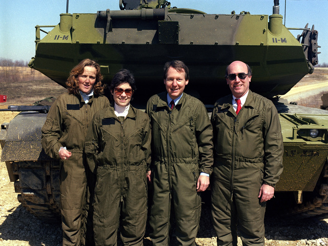 Sergeant Mitch McConnell of Kentucky and members of his staff gather for a photograph near an M1 Abrams main battle tank during their tour of the US Army Armor Center. They are, from left to right: Larry Cox, state director for the senator; Senator McConnell; Janet Mullins, McConnell's CHIEF of STAFF; and Robin Cleveland