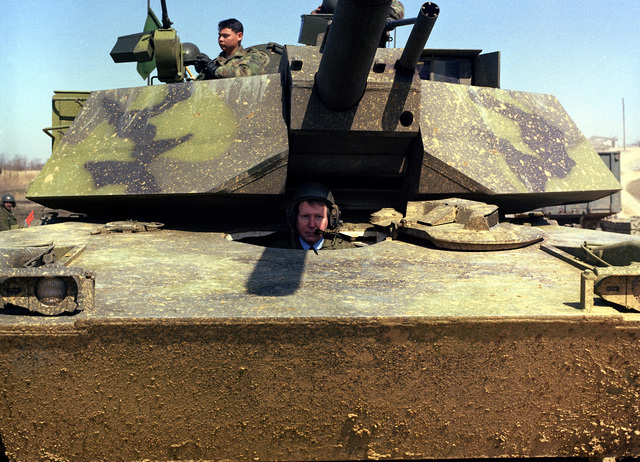 Sergeant Mitch McConnell of Kentucky sits in the driver's compartment of an M1 Abrams main battle tank during his tour of the US Army Armor Center