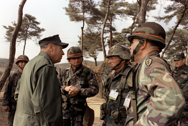 Adm. William J. Crowe Jr., commander in chief, Pacific Fleet, speaks with Army officers during the joint U.S./South Korean exercise Team Spirit '85. From left to right are Crowe, COL. L. J. Del Rosso, chief of staff, 25th Inf. Div.; COL. James T. Scott, commander, 3rd Brigade, 82nd Airborne Div.; and Maj. Gen. Claude M. Kicklighter, commander, 25th Inf. Div