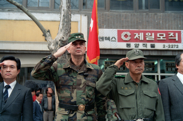 Major General (MGEN) Claude M. Kicklighter, Commander, 25th Infantry Division, is flanked by Kim Chu Ho, Governor of Kangwando Province, and Major General (MGEN) Pyur Don Soo, Commander, Korean army 27th Infantry Division, during a parade welcoming the Americans to Korea for the joint U.S./South Korean Exercise TEAM SPIRIT`85