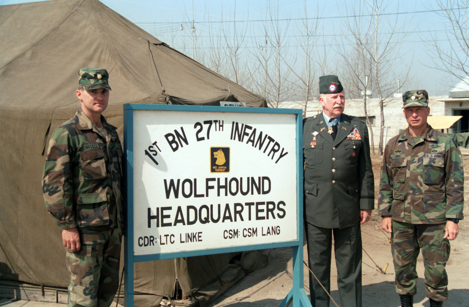 Retired Colonel (COL) Lewis Millett, a recipient of the Medal of Honor during the Korean War, visits his former unit, the 27th Infantry, 25th Infantry Division, during the joint U.S./South Korean Exercise TEAM SPIRIT'85.  On the left is Major (MAJ) Cole Kingseed, executine officer of the 1st Battalion, and on the left is Lieutenant Colonel (LTC) H.T. Linke, Commander