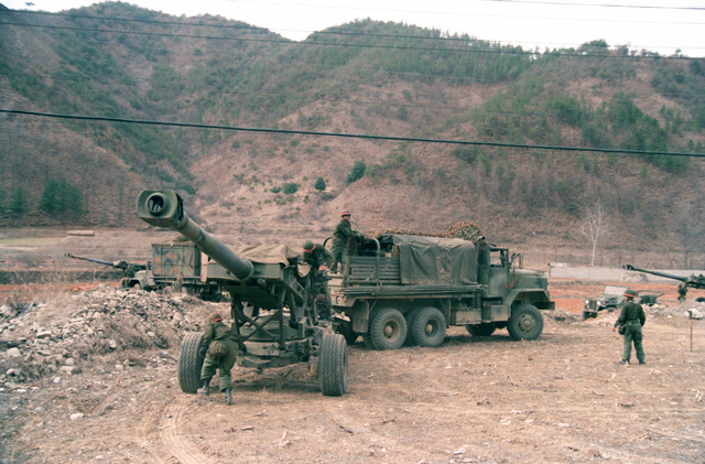 An M-198 155mm howitzer of the 8th Field Artillery Regiment, 25th Infantry Division, is moved into position by an M-923 5-ton cargo truck during the joint U.S./South Korean Exercise TEAM SPIRIT'85