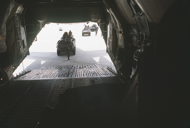 Marines from the 2nd Light Armored Vehicle Battalion, 2nd Division, prepare to drive LAV25 light armored vehicles into a C-5A Galaxy aircraft for a flight to Marine Corps Air Station, Cherry Point, North Carolina
