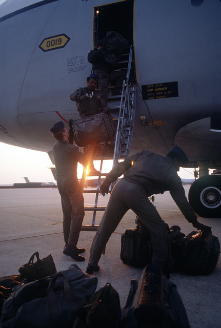 Members of the 9th Military Airlift Squadron, 436th Military Airlift Wing, load baggage onto a C-5A Galaxy aircraft for a flight to Marine Corps Air Station, Cherry Point, North Carolina
