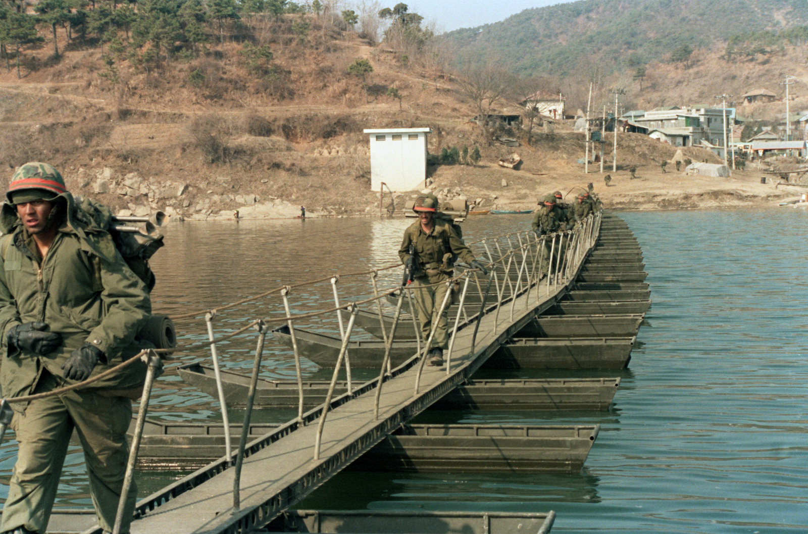 Members Of The 1ST Battalion 27th Infantry 25th Division Cross Nam Han River On An Aluminum Foot Bridge Built By 65th Engineer