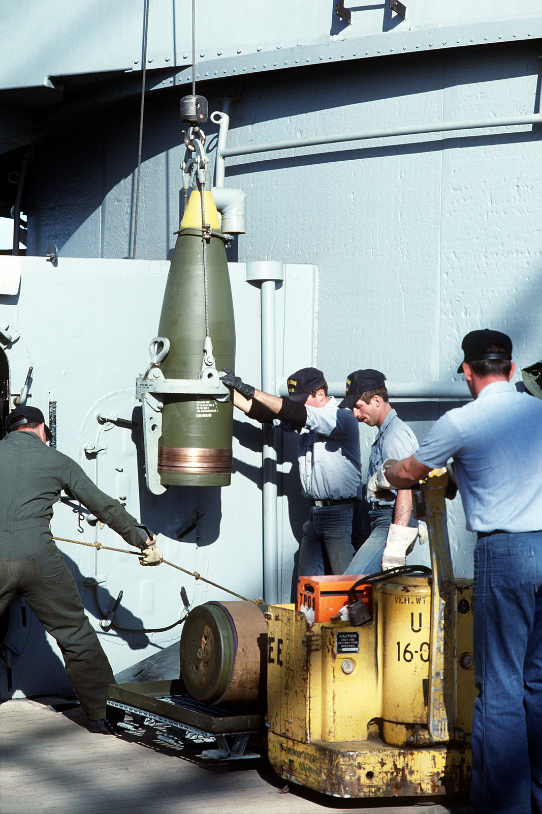 Naval Weapons Station  A 16-inch projectile is offloaded