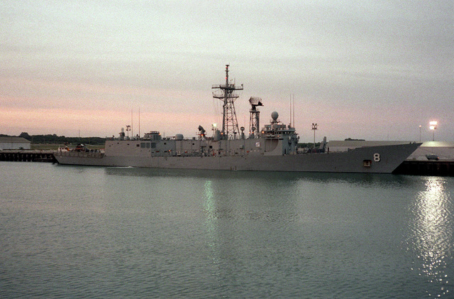 A starboard side view of guided missile frigate USS MCINERNY (FFG-8) in port at sunset. The ship is stopping over while en route to the U.S. after a Persian Gulf deployment