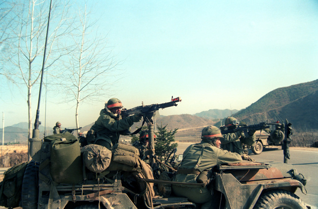 Members of Combat Support Company, 1ST Battalion, 5th Infantry, 25th Infantry Division, fire an M-60 machine gun and an M-203 40mm grenade launcher equipped M-16 rifle at opposing force aircraft during the joint U.S./South Korean Exercise Team Spirit'85.  Both weapons are equipped with blank firing attachments