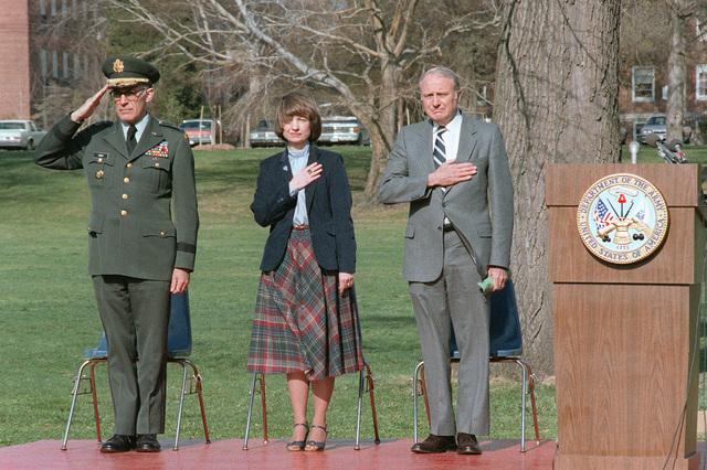 (Left to right) Lieutenant General (LGEN) William Odom director, National Security Agency; Mrs. Arthur D. Nicholson, widow of Major (MAJ) Arthur D. Nicholson, and Secretary of the Army John O. Marsh Jr., pay honors to MAJ Nicholson. MAJ Nicholson was shot and killed while on duty in East Berlin
